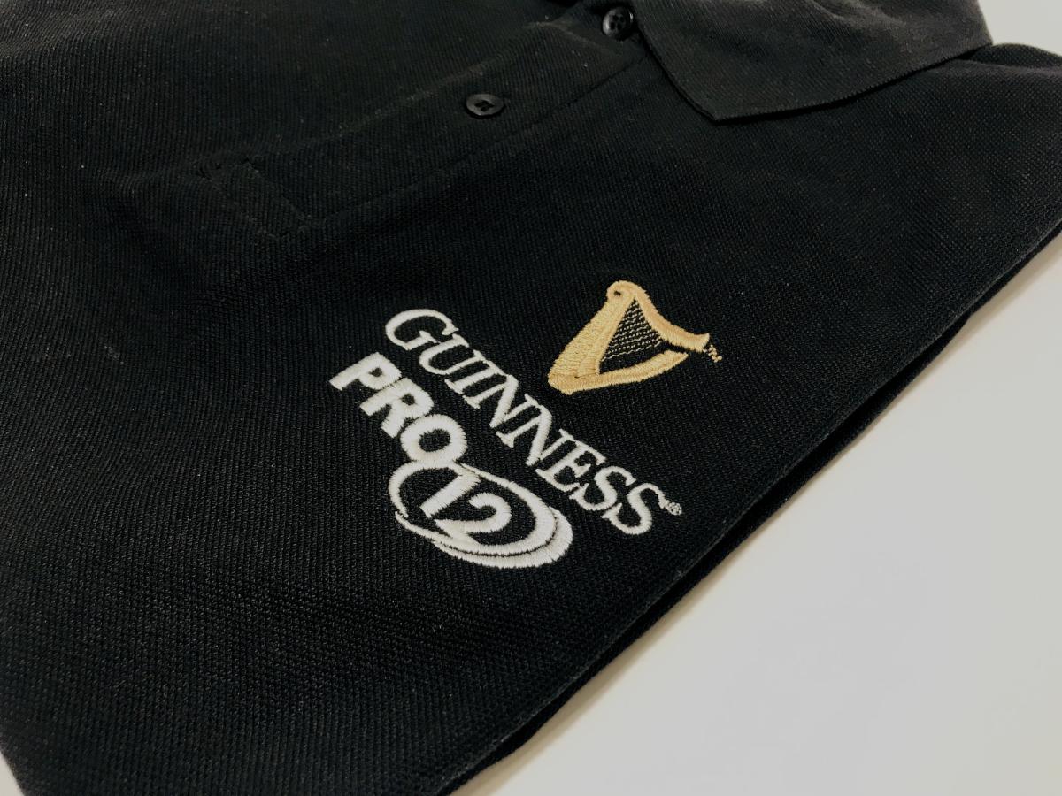 Koszulka polo GUINNESS. Haft loga browaru na okazje rozpoczęcia ligii w rugby. Polo z haftem reklamowym z Płocka.