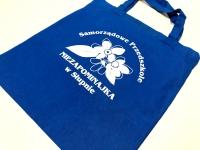 Samorządowe Przedszkole Niezapominajka w Słupnie. Torby bawełniane z nadrukiem. Niebieskie torby z krótkim uchem na zakupy. Płock